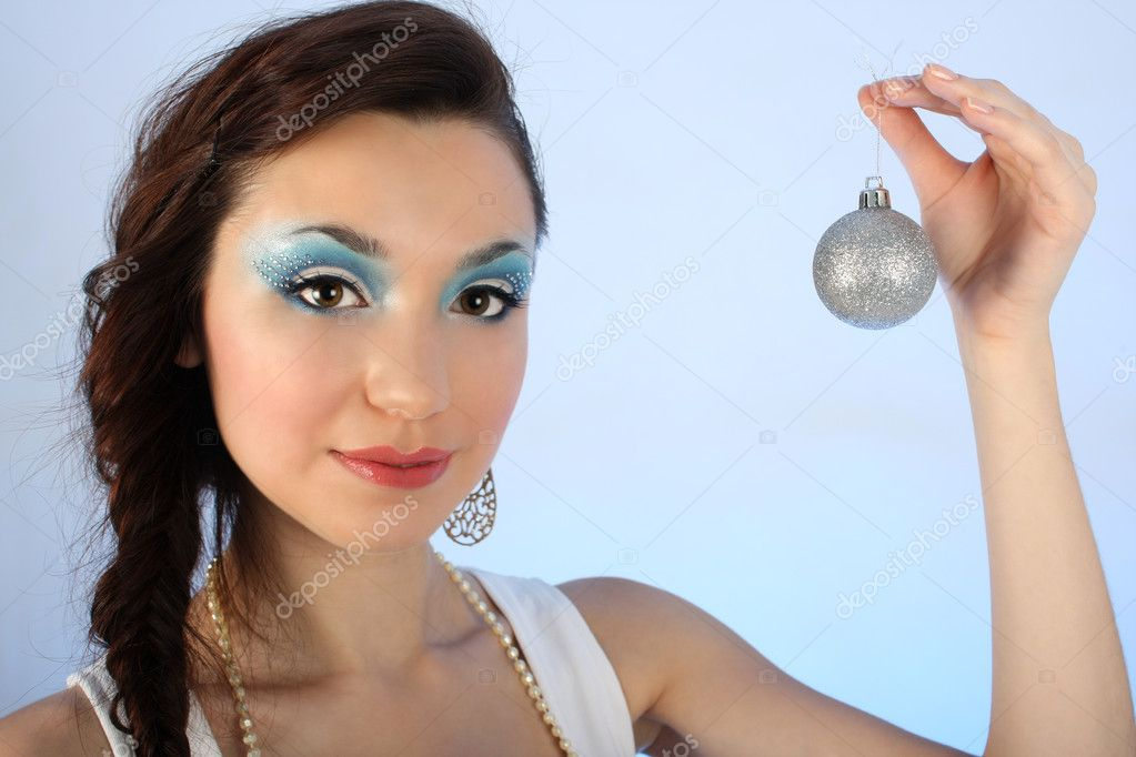Beautiful woman with christmas tree ball over blue background  Foto de Stock   #11791131