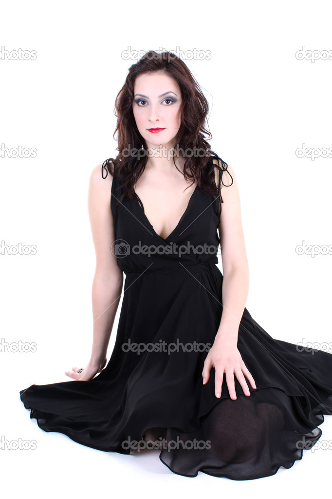 Brunette with red lips and smoky eyes in black dress sitting  Stock Photo #11792117