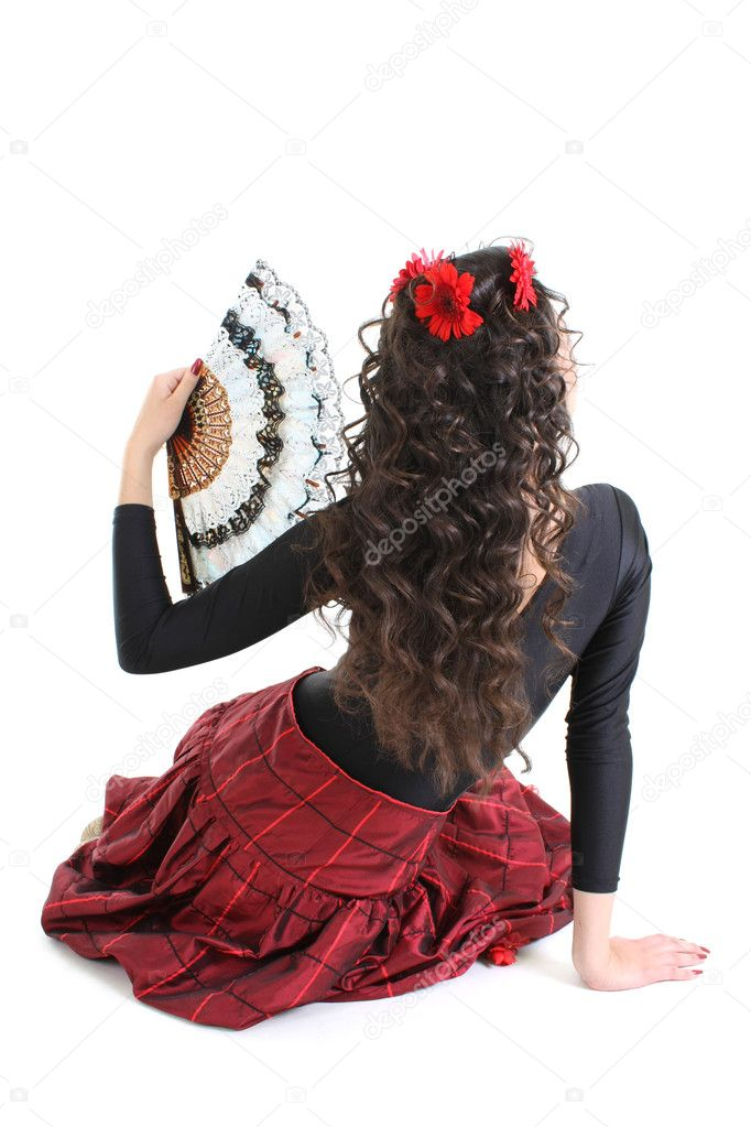 Young attractive woman with fan from the back — Stock Photo #11793201