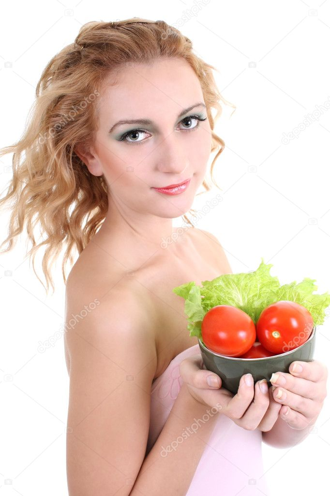 Portrait of young woman with salad and tomatoes over white background — Stock Photo #11794085