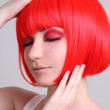 Attractive woman in red wig — Stock Photo #11839107