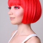 Beautiful woman in red wig — Stock Photo #11839125