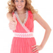 Stock Photo: Happy womin pink dress showing thump up