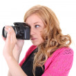 Woman with digital camera in hands — Stock Photo