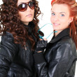 Stock Photo: Two glamorous woman in leather jackets