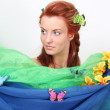 Red-haired woman with flowers and butterflies — Stock Photo