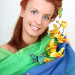 Royalty-Free Stock Photo: Red-haired woman with flowers and butterflies
