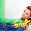 Red-haired woman with flowers and butterflies — Stock Photo #11839366