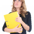 Business woman with yellow folder thinking — Stock Photo