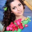 Brunette woman with flowers and butterflies — Stock Photo #11839385