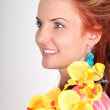 Red-haired woman with yellow orchid — Stock Photo