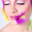Woman with creative make-up and feathers — Stock Photo
