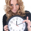 Woman in black with clock — Stock Photo #11839457