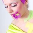 Woman with creative make-up and feathers — ストック写真