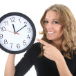 Happy woman in black with clock — Stock Photo #11839465