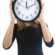 Woman in black with clock — Stock Photo #11839474