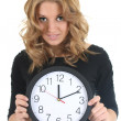 Woman in black with clock — Stock Photo #11839482