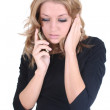 Sad woman speaking by phone — Stock Photo