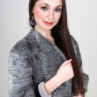 Woman in gray fur coat — Stockfoto