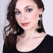 Happy woman in black with earrings — Stok fotoğraf