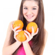 Happy teenager in pink with oranges — Stock Photo