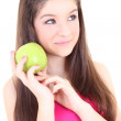 Dreaming girl with green apple — Stock Photo
