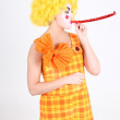 Royalty-Free Stock Photo: Funny clown in costume with whistle