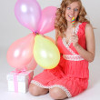 Royalty-Free Stock Photo: Birthday girl with gift, balloons and lollipop