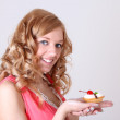 Happy woman with little cake in hand — Stock Photo #11839900