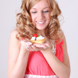 Stock Photo: Happy woman with little cake in hand