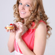 Happy woman with little cake in hand — Stock Photo