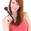 Happy teenager with make-up brush — Stock Photo
