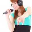 Happy teenager with headphones and microphone — Stock Photo