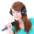 Stock Photo: Happy teenager with headphones and microphone