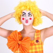 Funny clown in costume and make-up — Stock Photo