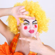 Stock Photo: Happy clown take photo