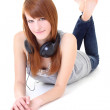 Happy teenager with headphones lying — Stock Photo #11839999