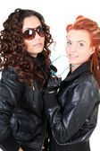 Two glamorous woman in leather jackets — Stock Photo