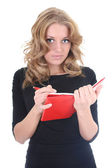Kvinnan i svart med röda anteckningar — Stockfoto