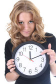 Woman in black with clock — Stock Photo