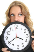 Thinking woman in black with clock — Stock Photo