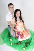 Pregnant wife and her husband sitting — Stock Photo