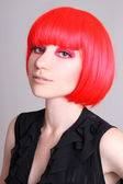 Portrait of woman in red wig — Stockfoto