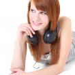 Happy teenager with headphones lying — Stock Photo #11840005