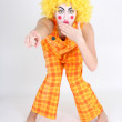 Clown in colourful costume showing something — Стоковая фотография