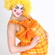 Happy clown with big abdomen — Stock Photo #11840076