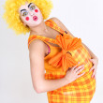 Happy clown with big abdomen — Stock Photo #11840077