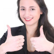 Young businesswoman with thumbs up sign — Stock Photo