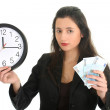 Businesswoman in suit holding a clock and money — Stock Photo
