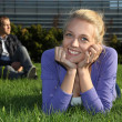 Womlying and msitting in park — Stock Photo #11840173